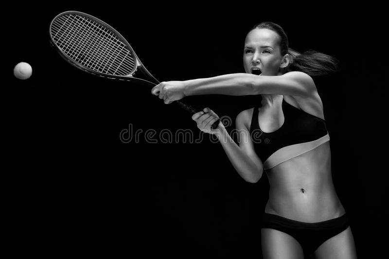 Download Young woman playing tennis stock image. Image of plays - 24384295