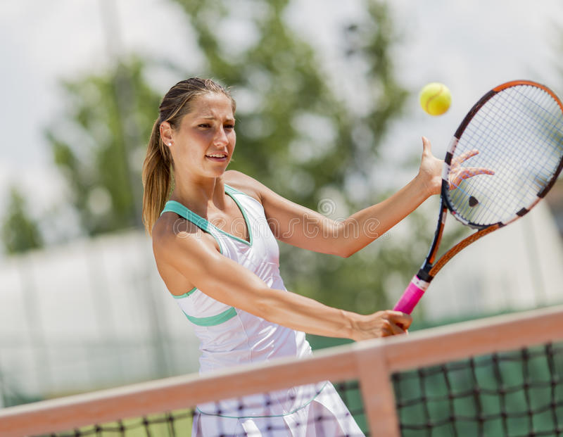 Download Young woman playing tennis stock photo. Image of player - 43210274