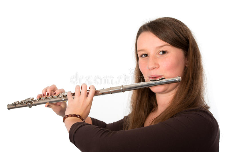 Young woman is playing the transverse flute stock photos