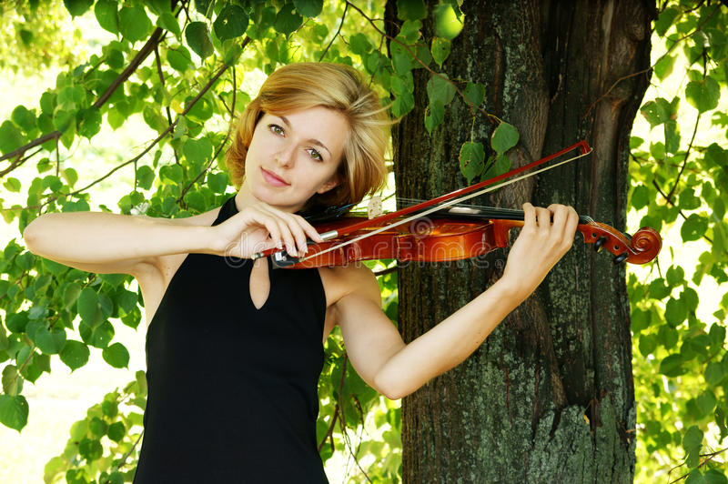 Young woman playing the violin stock images
