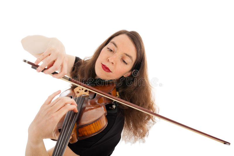 The young woman is playing the violin. The beautiful young woman is playing the violin royalty free stock images
