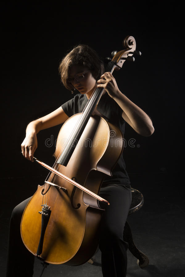 Download Young woman plays cello stock image. Image of bowing - 33608189