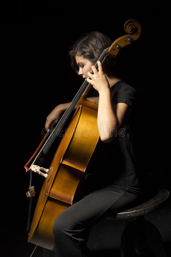 Download Young woman plays cello stock photo. Image of girl, classical - 33608080