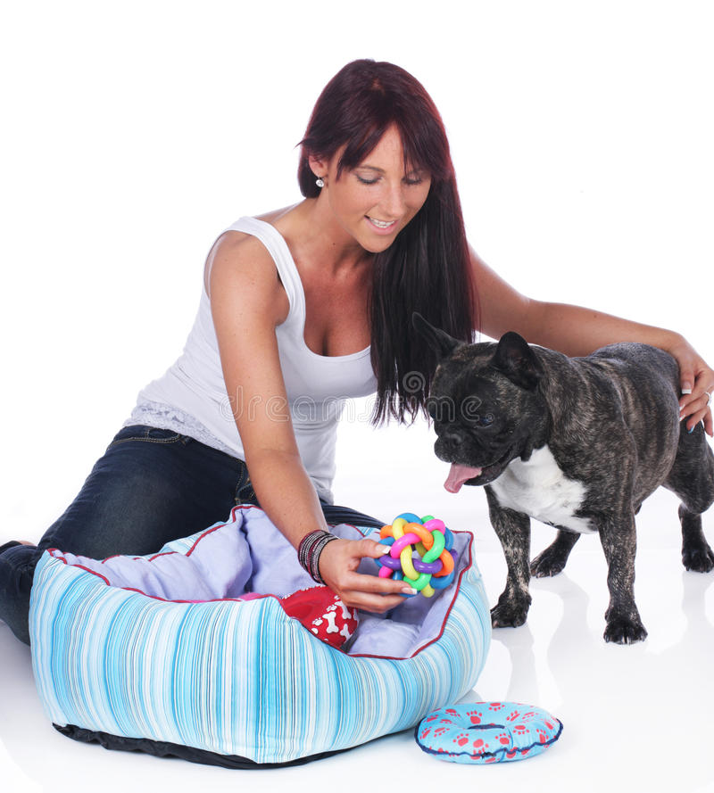 Young woman plays with french bulldog stock photography