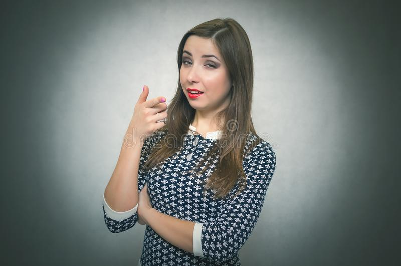 Young woman is pointing ahead. royalty free stock images