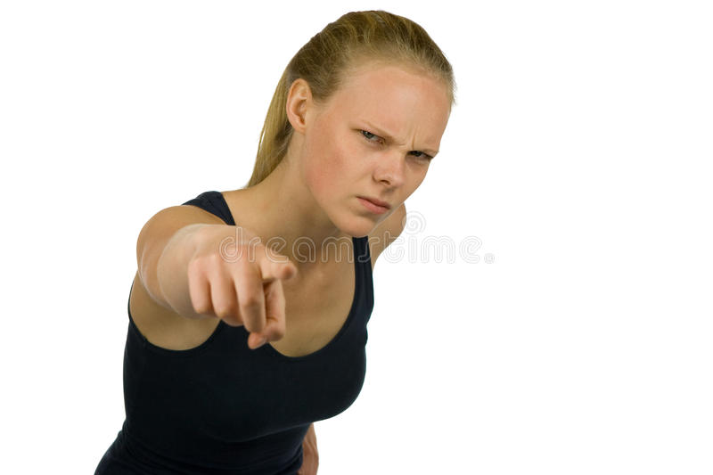 Young woman is pointing into the camera stock photography