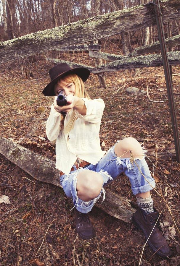 Download Young Woman Pointing Gun At The Camera Stock Photo - Image: 83724848