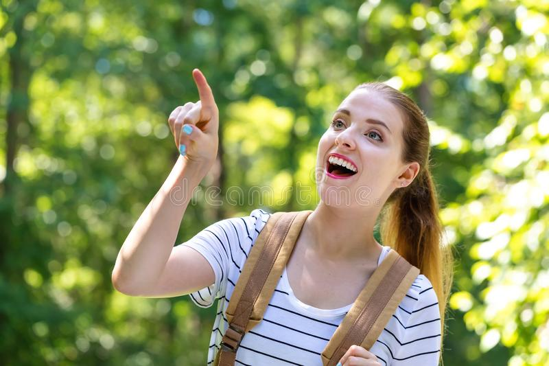 Young woman pointing while hiking royalty free stock photos