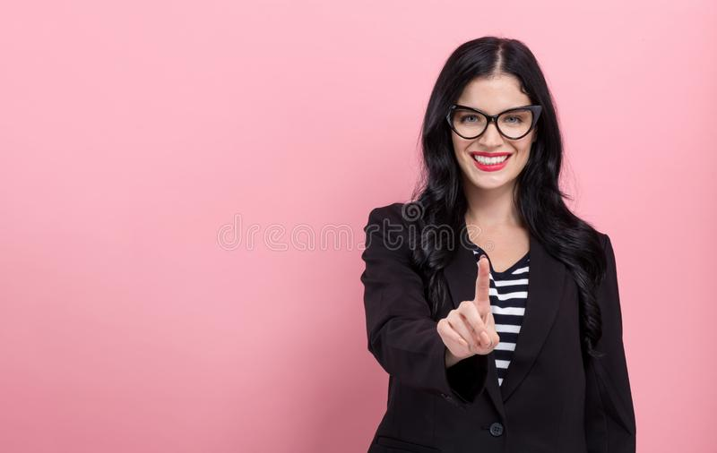 Young woman pointing at something stock photos