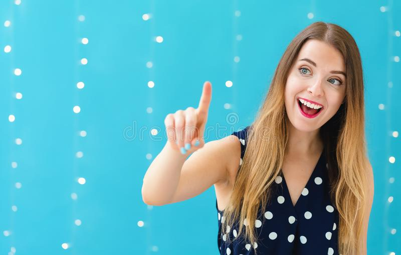 Young woman pointing at something stock photography