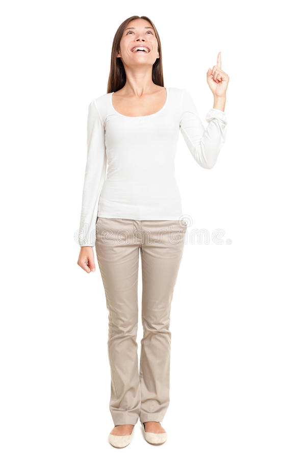 Young Woman Pointing Up At Copyspace stock photography