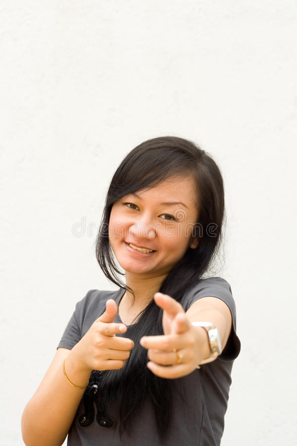 Young woman pointing at you royalty free stock images