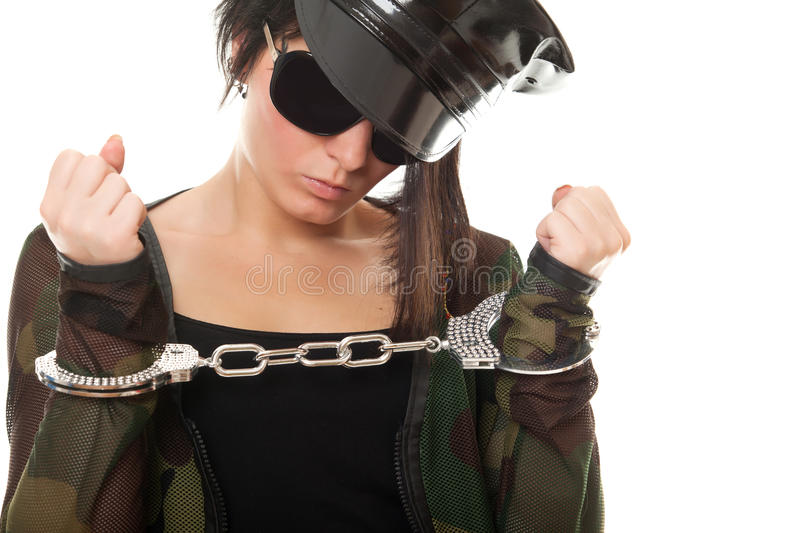 Young woman police officer with handcuffs stock photo