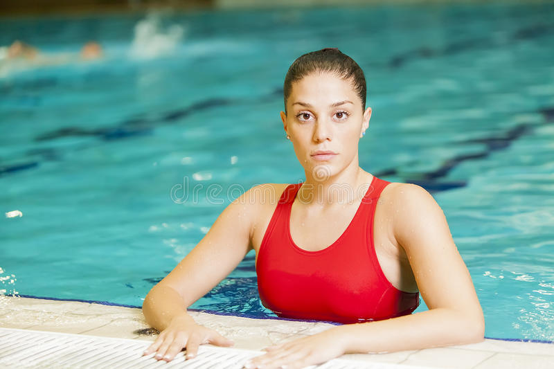Download Young woman in the pool stock photo. Image of being, person - 27966222
