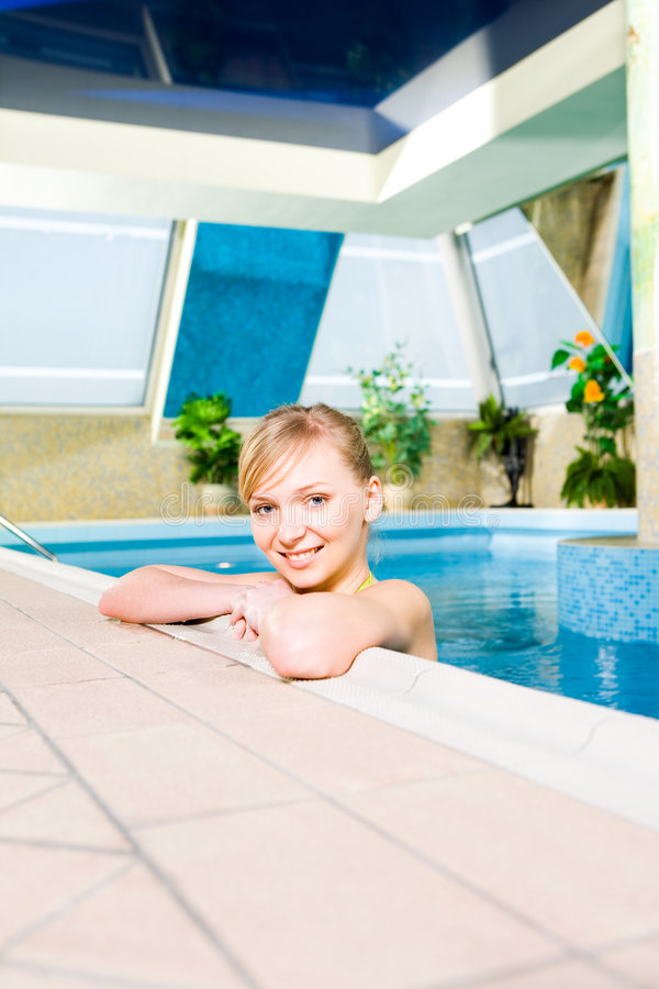 Young woman in pool royalty free stock photography