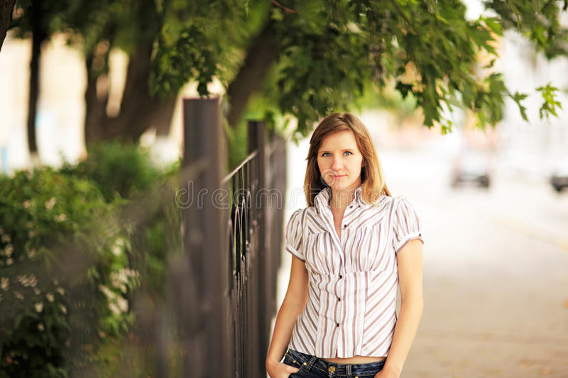 Young woman portrait in the city stock image