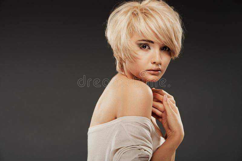 Beautiful woman face of white model with short blonde hair. royalty free stock photo