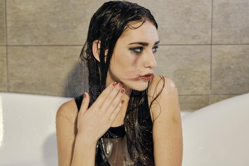 Young woman portrait with dripping smeared makeup stock photos
