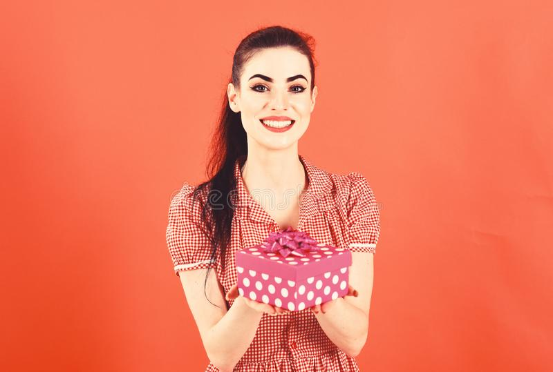 Young woman portrait hold gift in christmas color style . royalty free stock images
