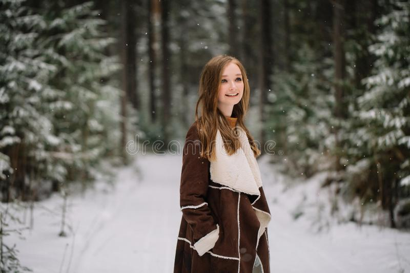 Young woman portrait winter in Christmas time stock photos