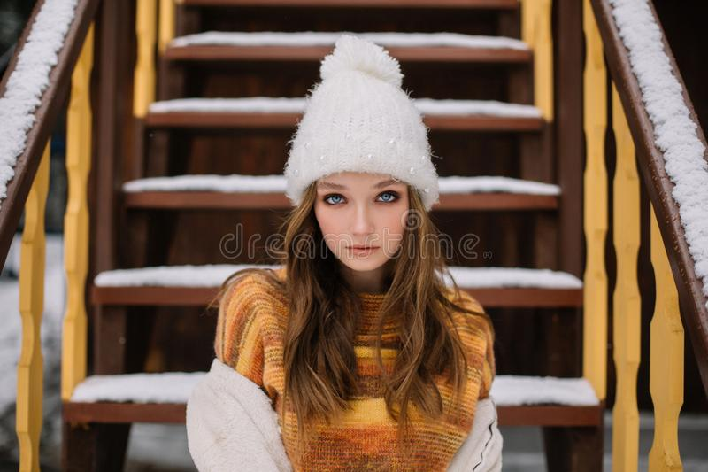 Young woman portrait winter in Christmas time stock photo