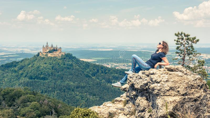 Young woman poses near Hohenzollern Castle, Germany stock photo
