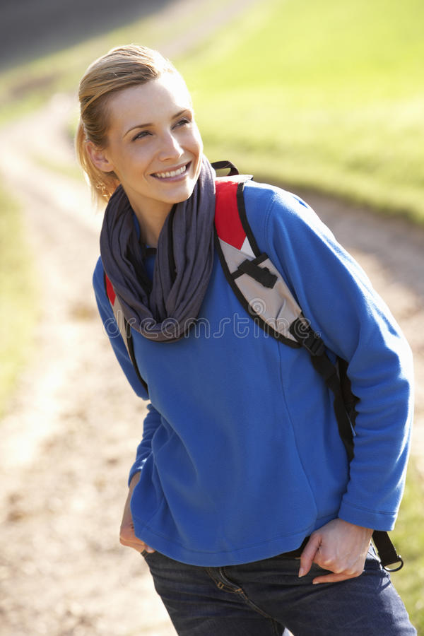 Young woman poses in park stock photography