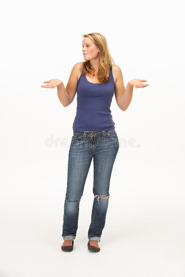 Download Young Woman Poses With Shrugged Shoulders Stock Image - Image: 17449145
