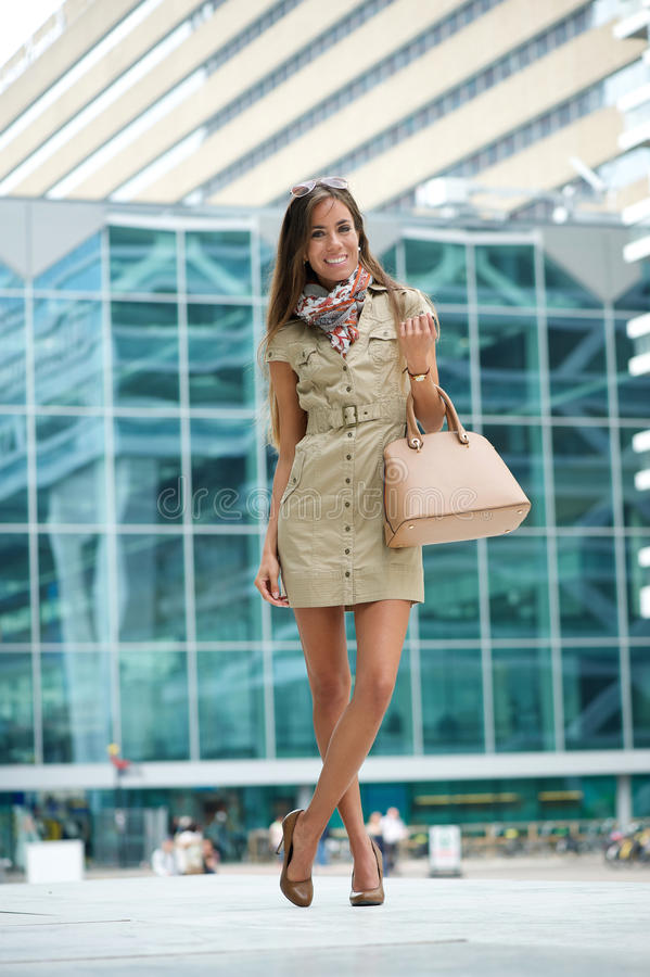 Young woman posing in the city with handbag stock images