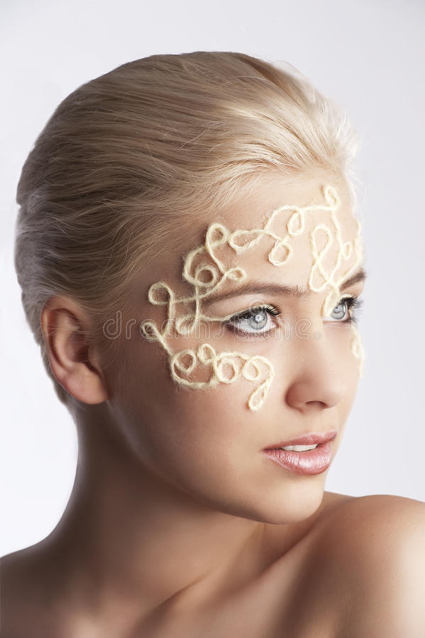 Young woman posing with a decor make up stock image