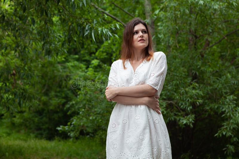 Young woman posing on forest background stock photos