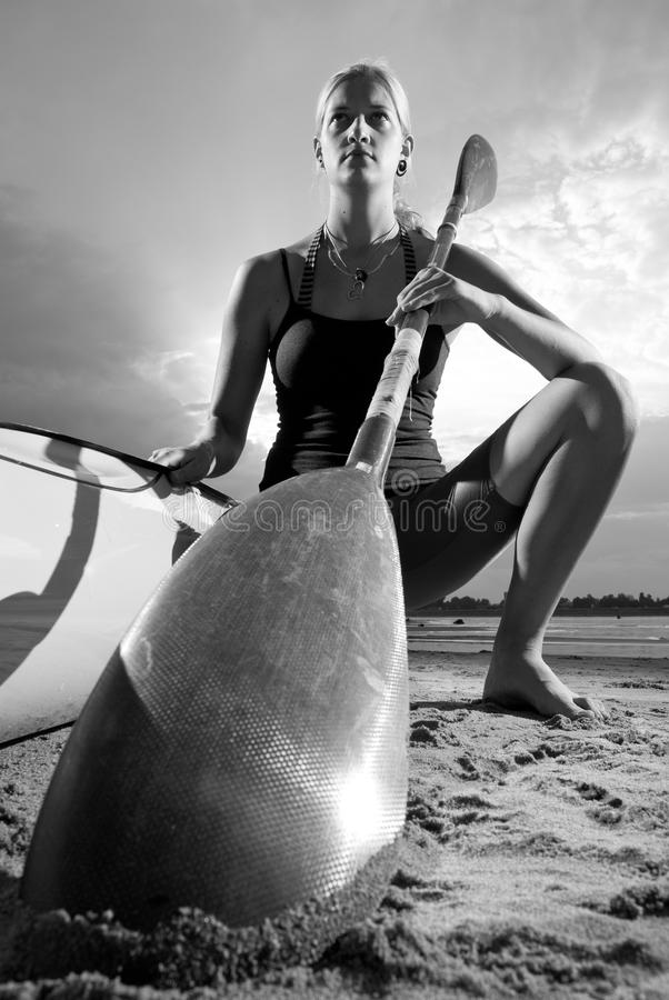 Download Young Woman Posing With Kayak Paddle Stock Image - Image of dark, coastline: 24656865