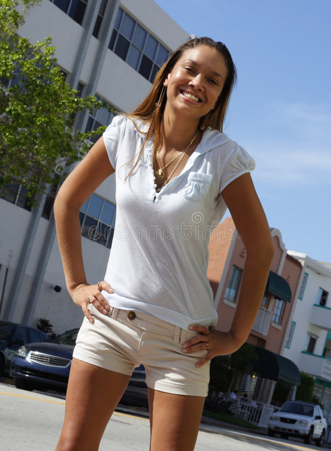Young woman posing on the street stock image