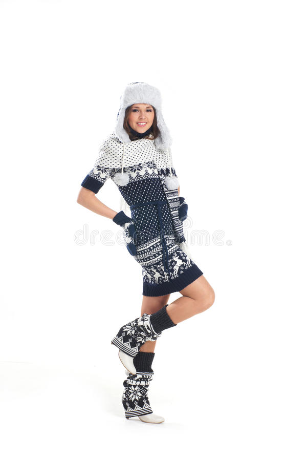 A young woman posing in warm winter clothes royalty free stock image