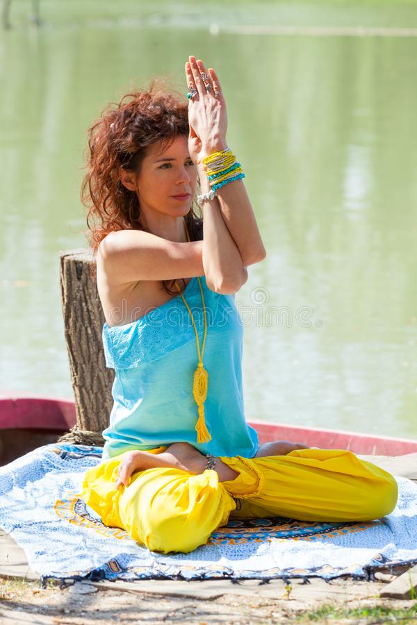 Young woman practice yoga outdoor by the lake healthy lifestyle concept  full body shot. Summer day vg stock photos