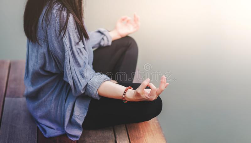 Young Woman Practices Yoga in Outdoor. Sitting in Lotus Position. Unplugged Life and Mental Health Concept. Sukhasana Posture and. Meditating royalty free stock photography