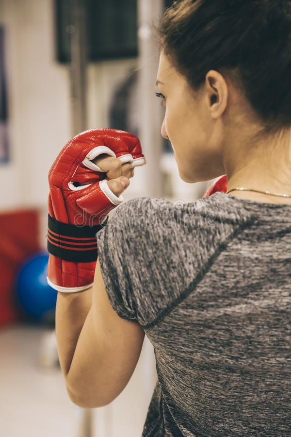 Young woman practicing boxing stock photo