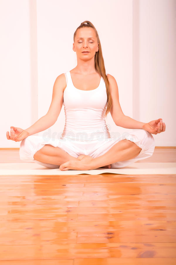 A young woman practicing meditation royalty free stock photo