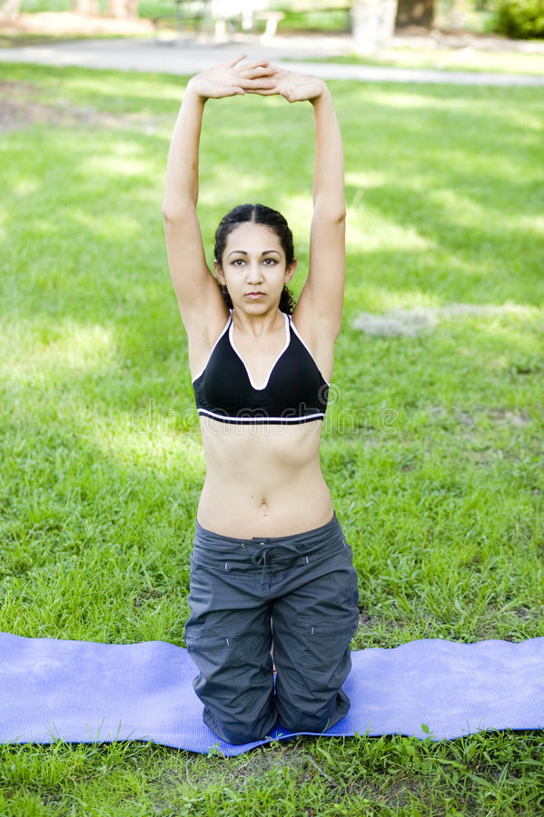 Young woman practicing Yoga stock photography