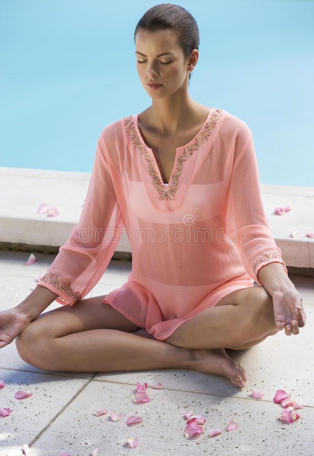 A young woman practicing yoga royalty free stock image