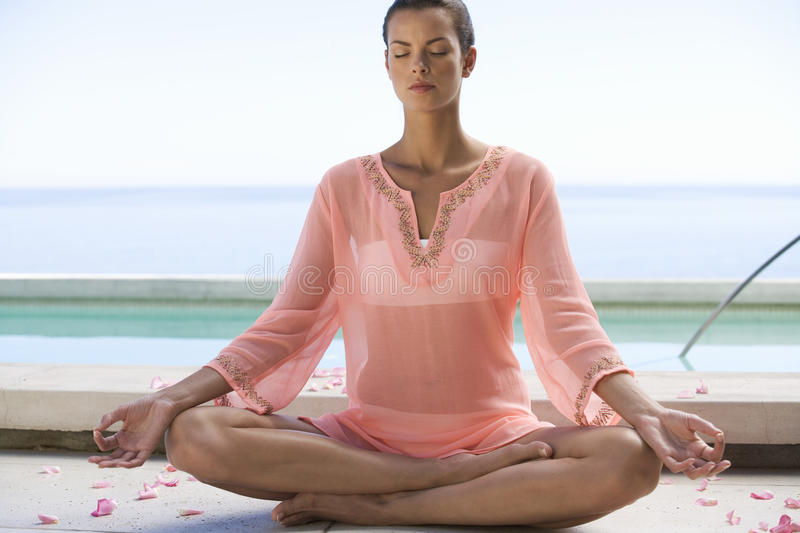A young woman practicing yoga royalty free stock photography