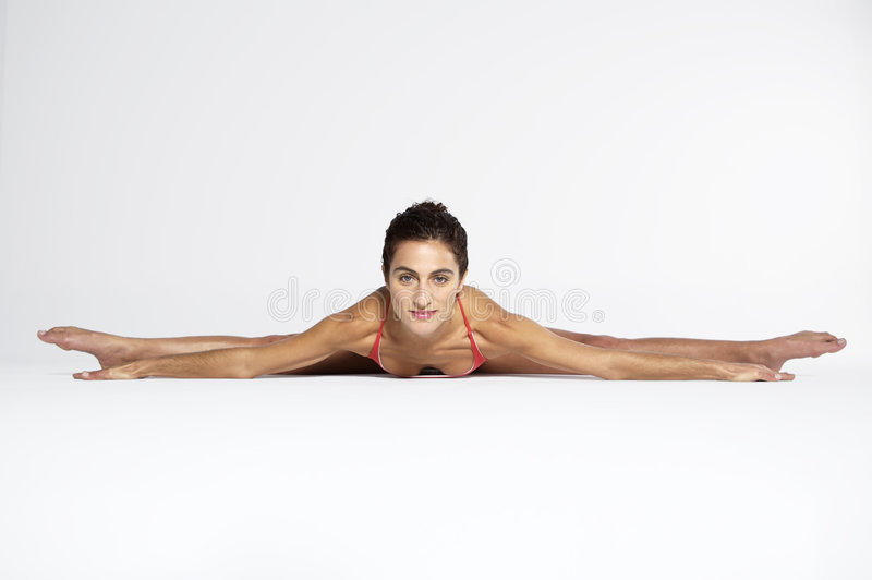 Young woman practicing yoga stock image