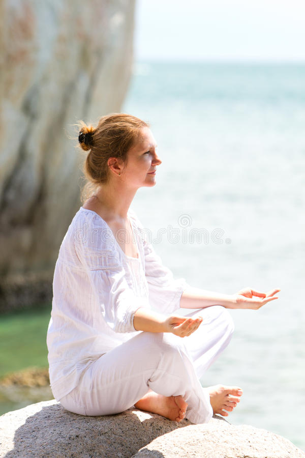 Download Young Woman Practicing Yoga By Coast Stock Image - Image: 16211683