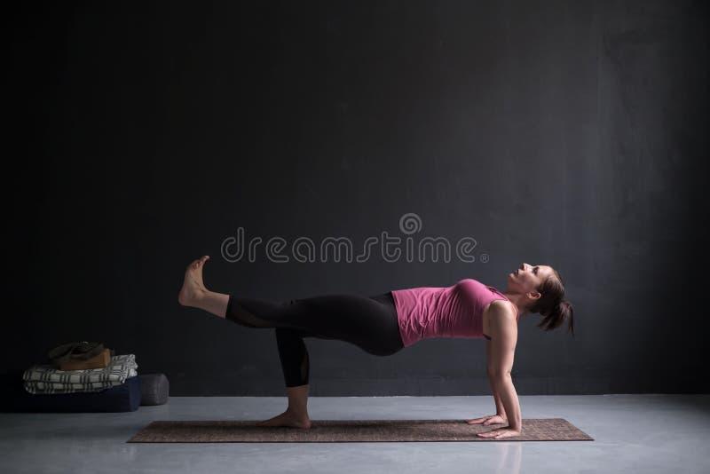 Woman practicing yoga concept, doing Purvottanasana exercise, Upward Plank pose stock image