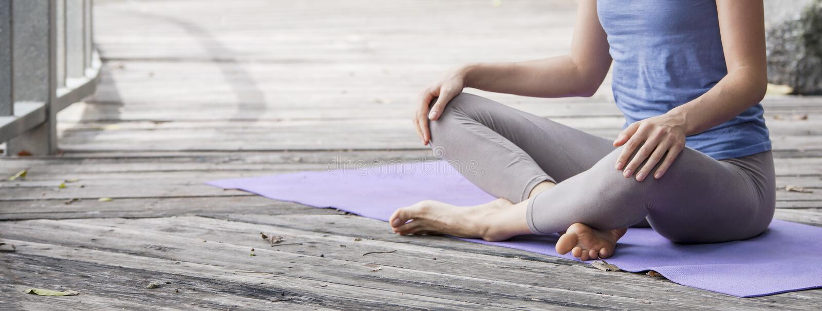 Young woman practicing yoga during yoga retreat in Asia, Bali, meditation, relaxation in abandoned temple stock photos