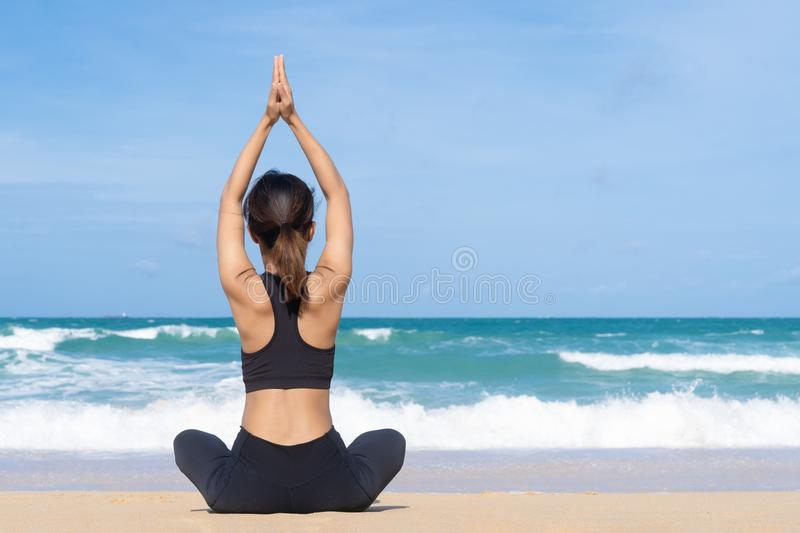 Young woman practicing yoga in the nature, Female happiness, Young healthy woman practicing yoga on the beach at sunrise stock images