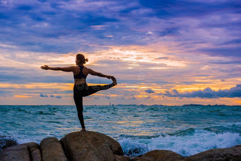 Women practicing yoga royalty free stock images