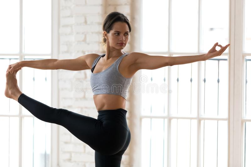 Young woman practicing yoga, Utthita Hasta Padangustasana exerci. Young sporty woman practicing yoga, doing Utthita Hasta Padangustasana exercise, Extended Hand royalty free stock image