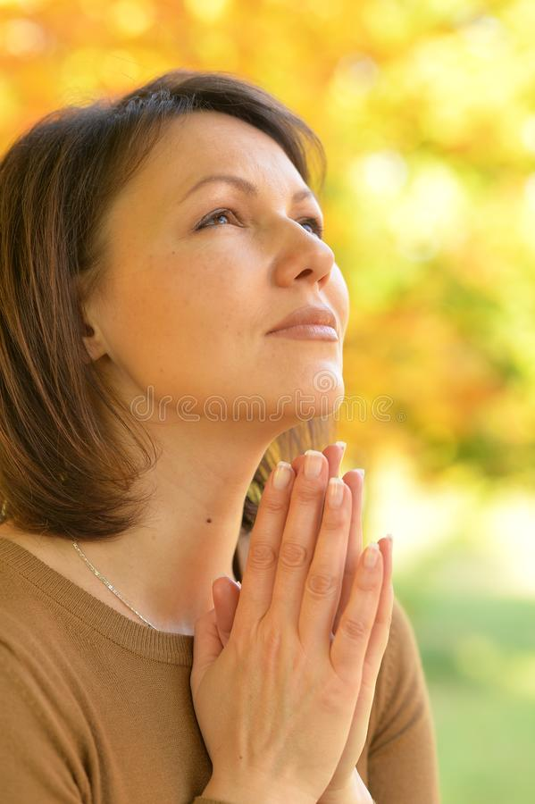 Close up portrait of young woman praying stock photography
