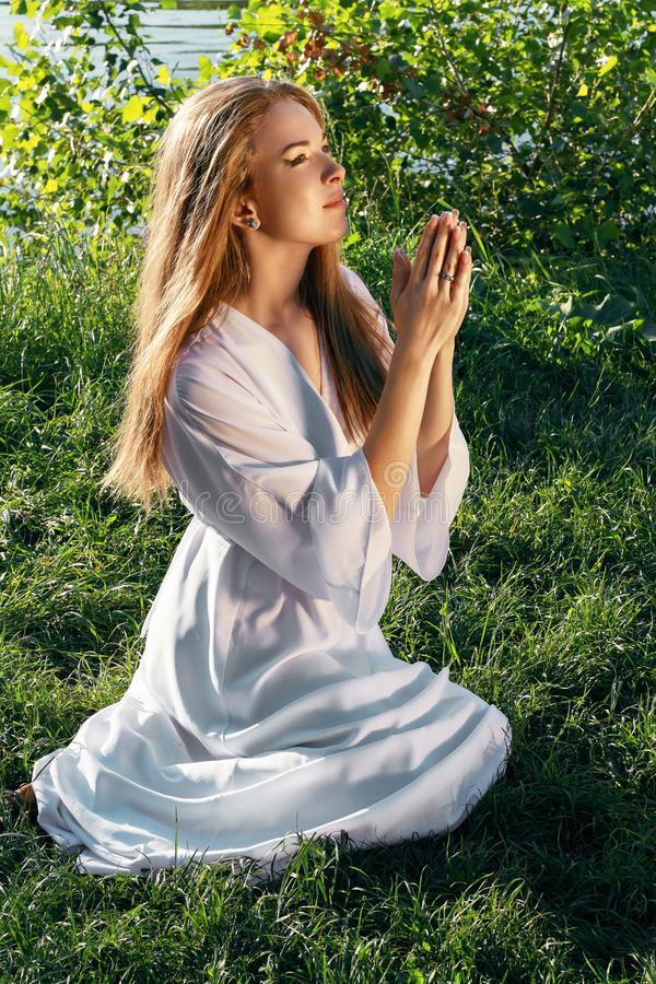 Young woman praying royalty free stock images